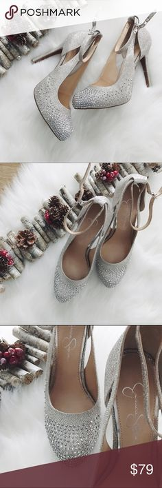 SALEJessica Simpson Silver Pumps These pumps are perfect for the Holidays! Size 8, heel height is 4 5/8 in., they have an adjustable strap, soft/light padding, super comfortable and stable. Textile upper, man made lining, cork sole. Brand new without tags.                     ✅MAKE ME AN OFFER✅         10% off bundle of 3 items or more!                             •NO TRADING                             •reasonable offers                             •smoke free…