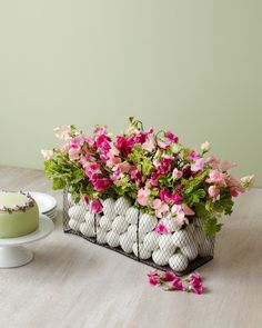 What you will need: •Sweet Peas ( I chose two shades of pink) •5 dozen plastic white eggs •Geranium leaves (or other greens) •A wire basket •A clear vase for inside the basket (to put the flowers in)  | tulipina.com / Kiana Underwood