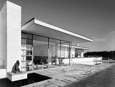 The Goodyear House  Considered one of the country's leading examples of the International Style, the A. Conger Goodyear home was built in 1938 with walls of windows, a flat roof, deep overhangs, and a signature circular dining room with curved glass walls.   It's still awesome!