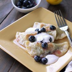 Lemon Blueberry Pierogi with Spiced Sour Cream, and step by step instructions for folding pierogies.