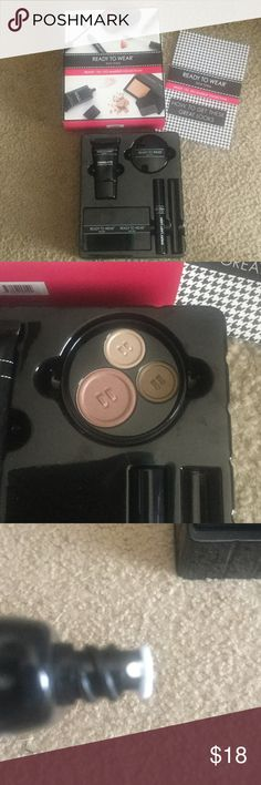Ready To Go Makeup Collection Ready To Go Makeup Collection, Comes with: Couture Finish Self Correcting Powder, Spotlight Eyeshadow Trio, Every Last Lash Amplifying Mascara in Black, Chameleon Custom Color Blush. It is missing Lip Lurex High Sheen Lip Gloss Ready To Wear Makeup