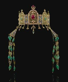 A gem-set and enamelled gold head-dress and a pair of ceremonial earrings (khros), Morocco, circa 1800