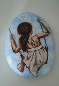 Girl on a swing painted rock!
