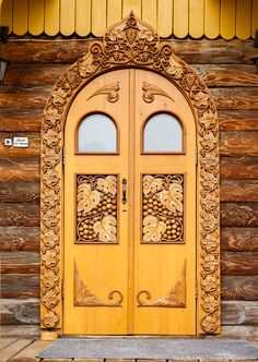 Russian wooden house in the Siberian city of  Krasnoyarsk. The entrance door decorated with carving. #architecture