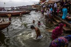 Example of poor sanitation with people washing in dirty water