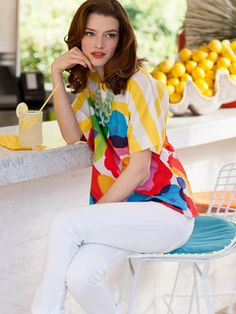 Love this look! Bright printed floral and striped pattern shirt with bright white pants
