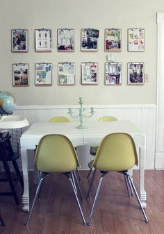 A brilliant idea for displaying things on the wall and you can change it as many times as you like! #wall_art #clipboards #chairs