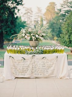 Elegant olive oil favor display: http://www.stylemepretty.com/2016/02/16/english-garden-style-wedding-in-california/ | Photography: Michele Beckwith - http://michelebeckwith.com/