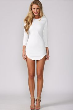 Long-sleeved white dress. Textured material. Bodycon fit. High round neckline.  Invisible back zip.  Inverted triangular hem at side.  Cotton/polyester.