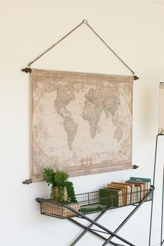 This canvas banner displays a beautifully aged world map that evokes old antique nostalgia. Featuring rustic metal supports and a metal chain hanger, it's easy to mount and will provide a timeless foc