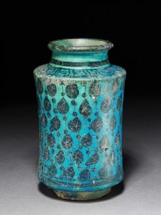 Albarello, or storage jar, with tear-drop shapes. Syria. Dated to the early 1200s, this small jar is one of the earliest know ceramic examples of an albarello