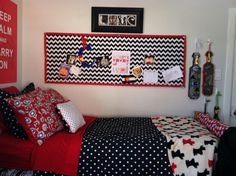 Chevron bulletin board, polka dot blanket, Scottish Terrier print blanket, and floral pillow in a dorm room. Mix and Match multiple patterns and stay with a color scheme. Busy but so cute! White, red, navy blue, and black
