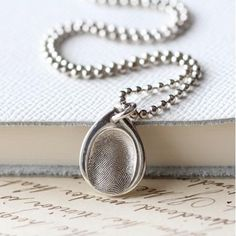 Teardrop FingerPrint Charm Necklace. The Teardrop FingerPrint charm can be personalised with a single fingerprint and a name up to 7 letters long. So many choices & such a wonderful gift to give and receive!