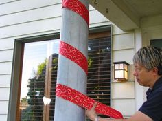 Wrap wide ribbon around poles and columns for a candy cane look.