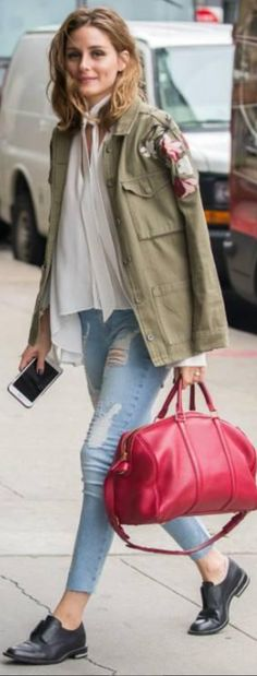 Who made Olivia Palermo's green jacket, red handbag, ripped skinny jeans, and black shoes?
