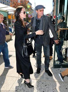 Family time: Brad Pitt and Angelina Jolie took twins Vivienne and Knox to a bookstore in New York on Tuesday