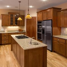 Oak kitchen cabinets paired with the rich, deep beauty of our Umber ...