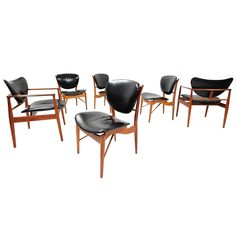 Set of Six Early Finn Juhl Walnut Dining Chairs with Original Ox Hide  | From a unique collection of antique and modern dining room chairs at https://www.1stdibs.com/furniture/seating/dining-room-chairs/