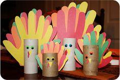 Handprint turkey kid craft. Made with empty toilet paper rolls.