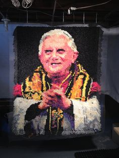 Pope Francis artwork made from colorful condoms