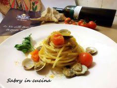 Spaghetti con vongole, pomodorini e bottarga