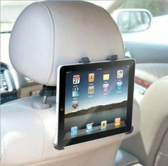 iPad Car Clip Holder: MP3 Players & Accessories  Traveling with children or backseat passengers? This is a nice way to mimic the TV or desktop computer in the car!