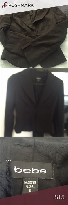 Bebe Black Crop Jacket Blazer Career-or-club blazer jacket with clean lines and faint striped detail also in black. 3 eye hook front closures. Fully lined. Arms have slight slit to finish of the stylish look or can cuff up. Size 0 . No longer fits. No rips no stains no holes. Cute with jeans or work pant. bebe Jackets & Coats Blazers