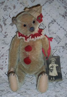 Gorgeous Clown Teddy....Such a sweet face ! I'm thinking this is a Simple Blessings Bear....Her bears are lovely !