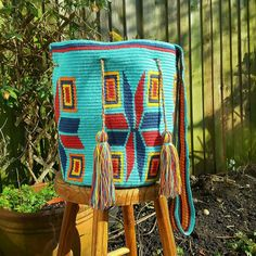 Blue Wayuu mochila bag from Colombia ~ this a cross body, drawstring closure, handmade bag made by a woman of the Wayuu tribe in La Guajira, Colombia. A perfect bag for the summer!