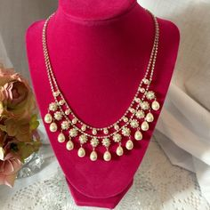 Stunning Pearl & CZ Tiered Necklace Stunning Pearl & CZ Tiered Necklace !  Brand New!  Exquisitely designed! Perfect for any formal occasion or just because you wanna wear it!  Excellent Quality!  16 inches! Jewelry Necklaces