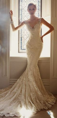 LOVING THE DELICATE MERMAID SILHOUETTE; ACCENTUATING THE WAIST, HIPS, KNEES BUT SOFT TOWARDS THE FULL, ROMANTIC HEM