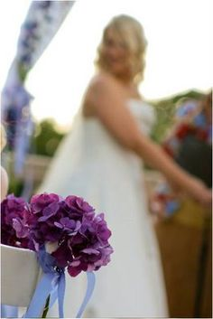 Purple flowers to decorate the guest chairs at the cermony