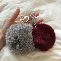 Furball Keychain Bundle Bundle includes: -Large gray fluffy fur keychain. -Medium burgundy fluffy fur keychain. Both feature ring & large lobster clasp. Perfect for clipping onto a purse or keeping your keys & swipe cards in one place! BNWOT. Genuine rabbit fur, dyed. Very little or no shedding. PINK Victoria's Secret Accessories Key & Card Holders