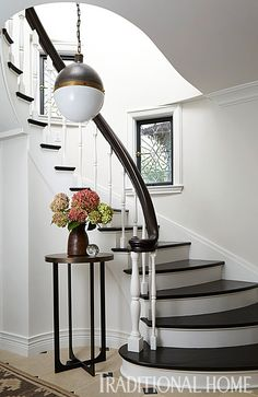 Leaded glass windows and a Circa pendant light become focal points in the otherwise neutral, pared-back foyer. - Photo: Werner Straube / Design: Summer Thornton