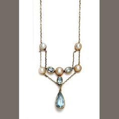 An early 20th century aquamarine and half pearl pendant necklace