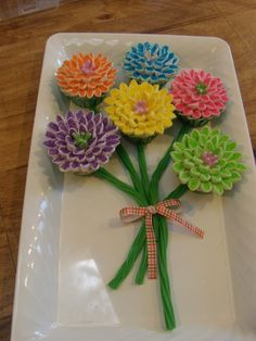 Flowers - you make the petals out of mini marshmallows cut diagonally length ways and then dip it into sprinkles.