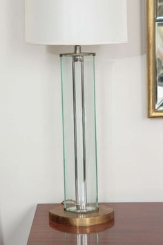 PAIR OF TABLE LAMPS DESIGNED BY ROBERTO GIULIO RIDA    Stunning pair of tall table lamps designed by Roberto Giulio Rida, and produced in Milan 2005. The lamp features two cut and polished bent glass pieces that make up a clean elliptic, topped by a beautiful finial.