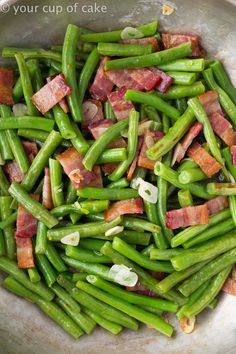 Bacon Garlic Green Beans is the side dish everyone will be begging for seconds of! This easy recipe is perfect for Thanksgiving or any weekday dinner! Easy Bacon Garlic Green Beans Thanksgiving for me is all about the stuffing, myamazing homemade rolls, turkey and gravy! Every year my mother puts green beans on the table …