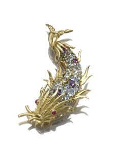 Ruby, amethyst and aquamarine brooch, Schlumberger, Tiffany & Co. Designed as a stylised fish, the scales set with circular-cut amethysts and aquamarines, the eyes with cabochon rubies, on an engraved mount, mounted in gold, signed Schlumberger Tiffany & Co.