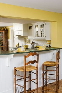 A large pass-through over the breakfast bar connects the kitchen to the family room.