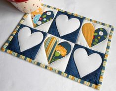 And here is the Half Hearted  Mug Rug in yellow and navy.