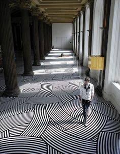 This beautiful graphic floor in a traditional building with classic architectural elements is perfect!