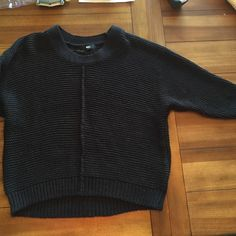Black Sweater Warm and cozy black 3/4 sleeve sweater. Excellent condition, no rips, tears, piling or other imperfections. The sweater has some slight sparkle to it with silver (hard to capture in photos) Mossimo Supply Co Tops