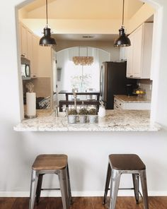Kitchen Makeover. From oak cabinets and formica countertops to granite, white cabinets, a farmhouse sink and subway tile for a bright white kitchen.