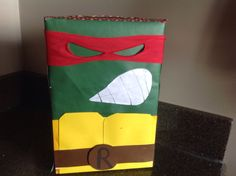 Raphael Teenage Mutant Ninja Turtle Valentine box. I found this idea on Pinterest and had to make it for Jack! Here is our version out of a cereal box.