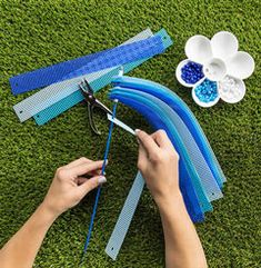 Looking for Yarn & Needle Arts projects? Visit Hobby Lobby for DIY Spiral Spinner project details. Plastic Canvas Coasters, Plastic Canvas Ornaments, Plastic Canvas Tissue Boxes, Plastic Canvas Christmas, Plastic Canvas Crafts, Plastic Canvas Patterns, Aluminum Can Crafts, Wind Spinners, Garden Spinners