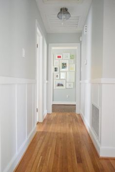 Benjamin Moore Moonshine is a bright panit colour for a dark hallway. Looks good… Benjamin Moore Moonshine is a bright panit colour for a dark hallway. Looks good with board and batten, wainscoting and wood flooring by Young House Love Flur Design, Upstairs Hallway, Upstairs Landing, House Colors, Small Spaces, New Homes, Sweet Home, House Ideas, House Design