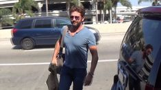 Gerard Butler is unable to hide his smile as girlfriend Morgan Brown greets him at LAX | Daily Mail Online