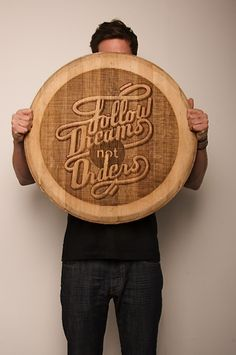 Wine barrel lids converted into cheese boards with custom engraved typography.