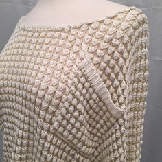 Cream & Gold Open Work Shrug Beautiful free-flowing openwork sweater with ribbed details on sleeves and hem. Sweaters Shrugs & Ponchos